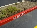 Curb markings in red saying No Parking