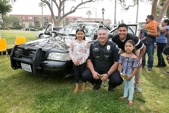 Officer with Kids at SpringFest with open police car
