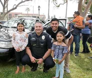 Officer with Kids and Police Car at Spring Fest