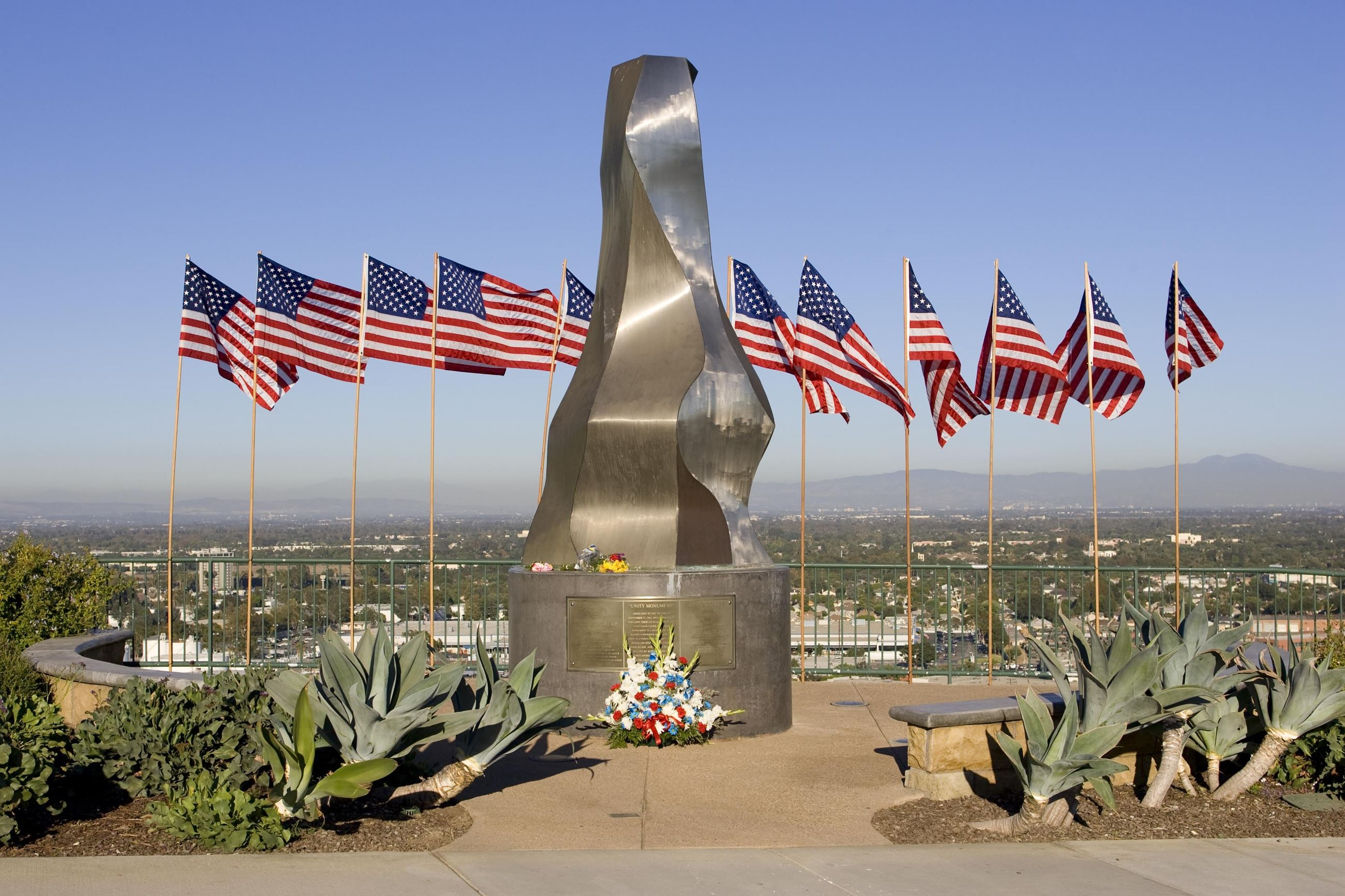 Unity Monument with American flags and flowers