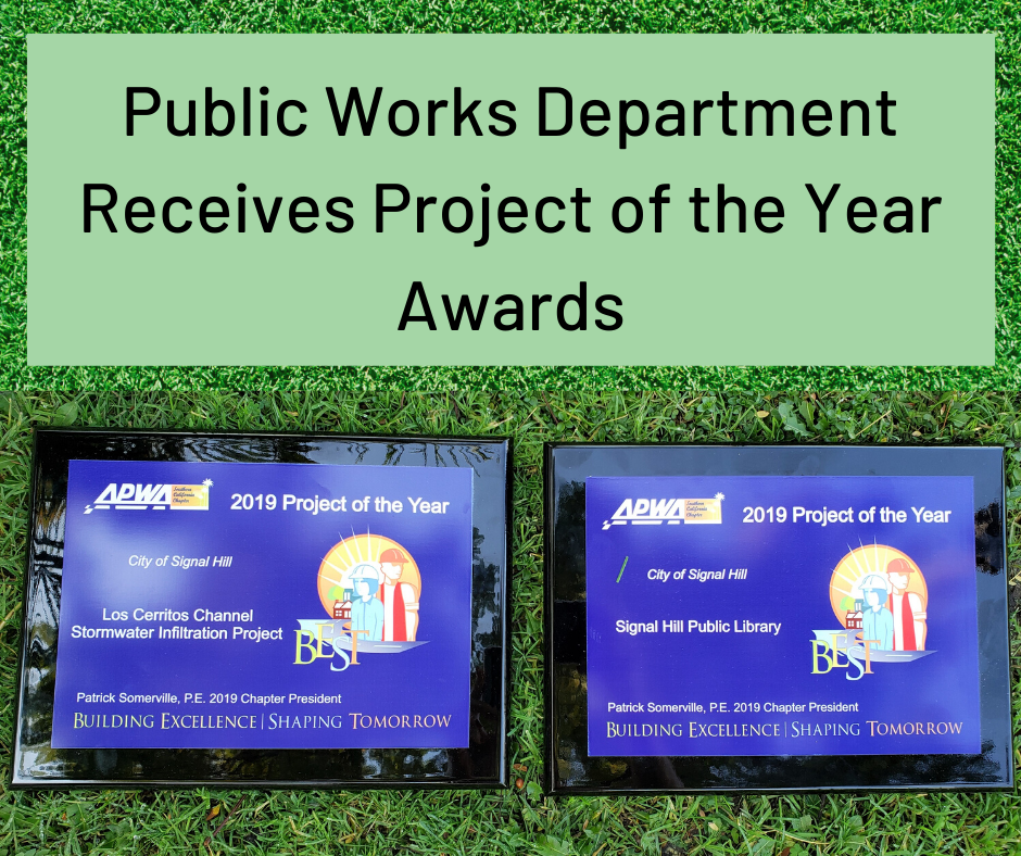 Grass background with two award plaques Public Works Receives Awards