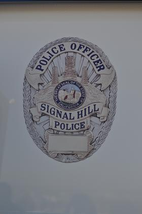 Department badge on a police car