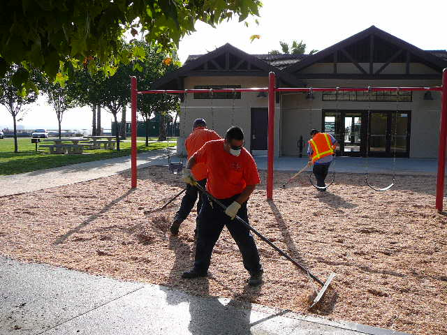 People working on a playground