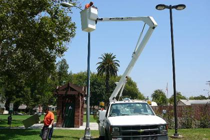 Person changing a light at a park